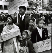Ossie Davis and Ruby Dee and their children picketing for a cause