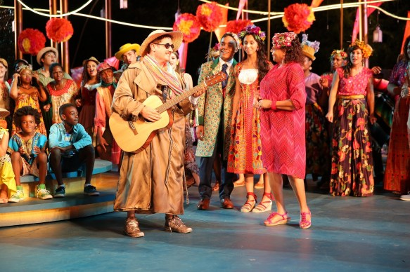 Christopher Fitzgerald (with guitar) in Lear deBessonet's The Winter's Tale