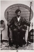 Photography attributed to Blair Stapp Composition by Eldridge Cleaver Huey Newton seated in wicker chair, 1967 Lithograph on paper Collection of Merrill C. Berman