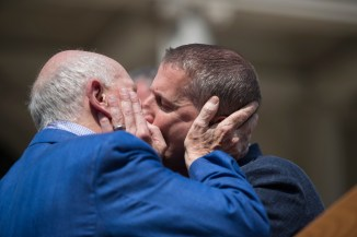 Terrence McNally and his husband Tom Kirdahy kissing on the day that New York State made same-sex marriage legal