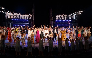 """The hundreds of New Yorkers from all five boroughs gather on stage at the end of The Odyssey at the Delacorte in Central Park, singing """"Welcome Home."""" It felt like a declaration: We all belong."""