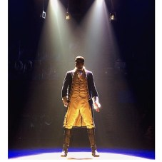 "In Hamilton, at the moment when Leslie Odom Jr. as Aaron Burr realizes he's been outsmarted and betrayed, he sings ""I wanna be in the room where it happens,"" a spectacular rhythm and blues number that is as insightful about political power as it is exciting to watch."