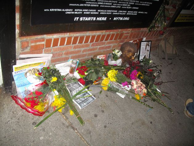Flowers and other items honoring David Bowie outside the New York Theatre Workshop