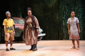Kecia Lewis as Mother Courage with two of her children, portray by Deandre Savon and Mirirai Sithole