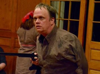 Craig Anderson as Jackson, mauled at the factory