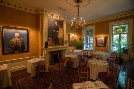 The Kinstler Club offers dinner to members on Friday nights. Portrait at far left is of Christopher Plummer