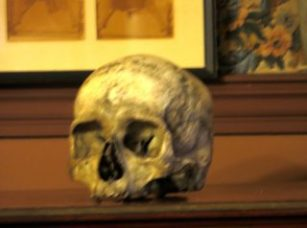 The skull used by Edwin Booth when he played Hamlet. It sits atop a bookcase in his still-intact bedroom.