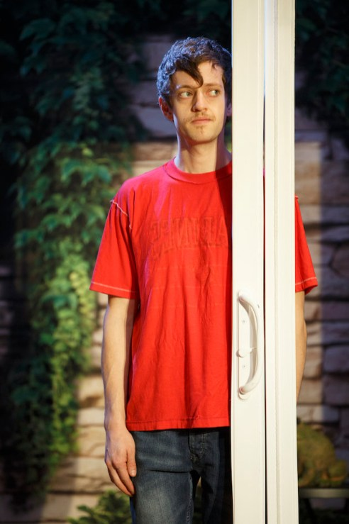 Ethan Dubin as the weird teenager