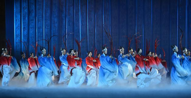 Confucius began with a few seconds of a realistic-looking video showing the dramatic landscape of Zhou Dynasty China (complete with dark clouds gathering overhead), before the curtain rose to reveal row upon row of performers bathed in stage smoke and glowing blue light, then glowing yellow, then glowing red. In alternating rows, the men — dressed in bright blue billowing robes with flowing sleeves – and the women — in deep red – leapt and bounced and bowed, and then circled one another with dignity and grace. It was stunning. Opened in January.