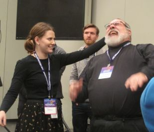 Fight director L David Brimmer teaches BroadwayCon fan how to (look like she) hurt him.