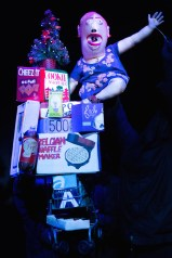 """Made in China, a satirical puppet musical, was """"inspired by true events,"""" according to Wakka Wakka, the theater company that produced it. I suspect the true part doesn't include an American named Mary and her neighbor getting sucked down her toilet and winding up in the People's Republic of China, where a dragon eats them. In any case, one of the most memorable moments occurred before that event, when Mary's household appliances came to life, explaining that they were made in China – such as a toilet plunger. A gun sings: I was made by children in Hunan! Fifteen hours each day, they're having fun! Safely tucked away from awful sun make for you the cheapest All-American gun! Pointed satire about worker exploitation and gun violence all in one verse. It was…memorable. Opened in January."""