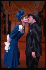 """Nathan Lane and Faith Prince kissing in a scene from the Broadway revival of the musical """"Guys And Dolls""""."""
