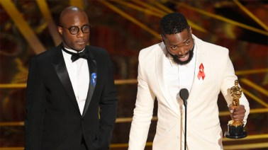 "Barry Jenkins, left, and Tarell Alvin McCraney accept the award for best adapted screenplay for ""Moonlight"""