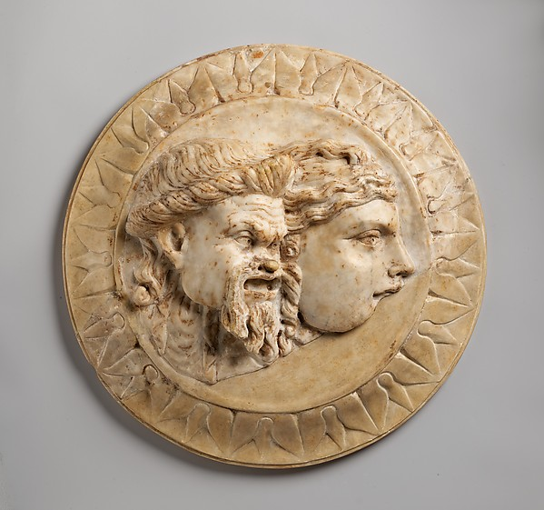 Marble disk with two theater masks in relief, 3rd quarter of 1st century A.D. Roman, Early Imperial Marble; Diam.: 13 1/16 x 3 3/8 in. (33.2 x 8.5 cm) The Metropolitan Museum of Art, New York, Rogers Fund, 1913 (13.229.6) http://www.metmuseum.org/Collections/search-the-collections/248802