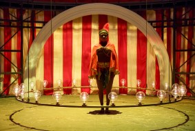 """Venus is a play based on the true story of an early 19th century woman from Africa who was exhibited in freak shows in Europe. The very first thing we see on stage is the character/actress putting on a nude body suit, with the aid of a man dressed like a circus ringmaster. Then she poses for us, """"naked"""" save for a scant loin cloth. The unspoken question: Are we, the spectators in 2017, all that different from the ones who paid two shillings in 1810? Opened in May"""