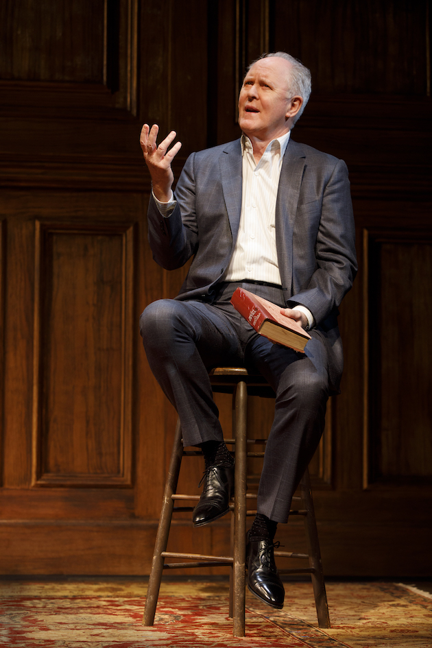 John Lithgow, holding the book Tellers of Tales edited by Somerset Maugham