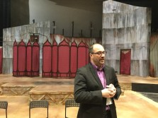 "Brian Isaac Phillips, CSC's producing artistic director in front of the set for the current production of ""Othello."""