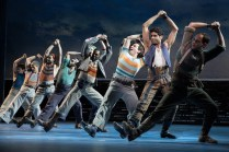 """Justin Peck choreographed spectacularly muscular choreography for """"Blow High, Blow Low"""" in Carousel, starring Amar Ramasar, in front of Santo Loquasto's picturesque set of a working seaport that seemed lifted from great American paintings by Thomas Eakins and Edward Hopper."""