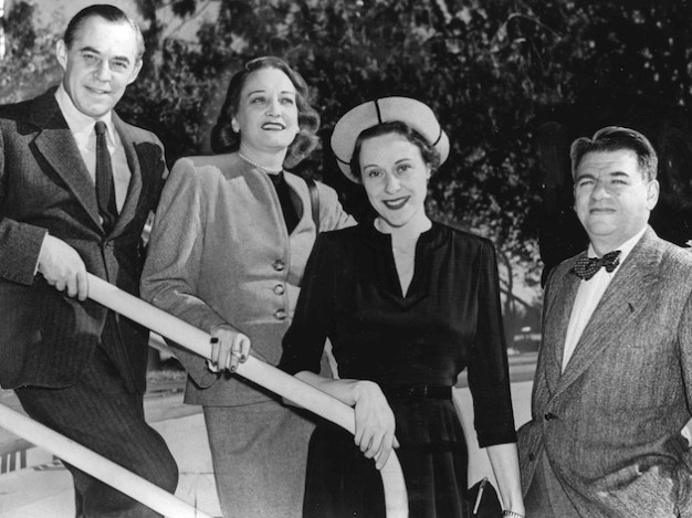 from left to right: Richard Rodgers, Dorothy Hammerstein, Dorothy Rodgers, Oscar Hammerstein. Both their wives were named Dorothy, and both were interior decorators.