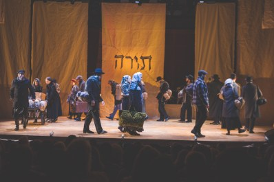 A Fiddler on the Roof finale. The word on the backdrop is Torah