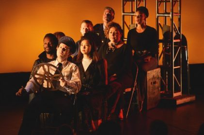 68 - a new American musical. Depicted from left: Uton Evan Onyejekwe, Jonathan Spivey, Delphi Borich, Jeremy Konopka, Bob Gaynor, Nicole Paloma Sarro, Jalynn Steele. Photo credit: Michael Kushner