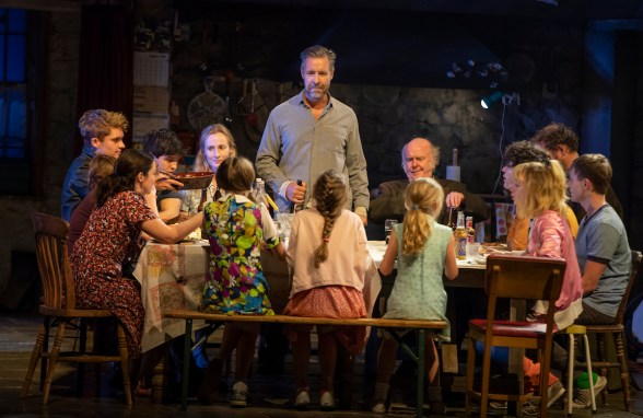 Paddy Considine as Quinn Carney (center, standing) and the company of The Ferryman