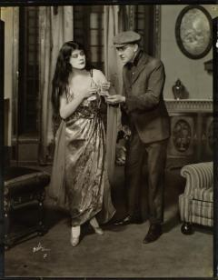 Theda Bara and unidentified actor in the stage production The Blue Flame, 1920