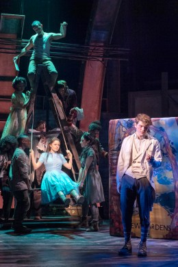 Molly Gordon and Colton Ryan in front of the cast