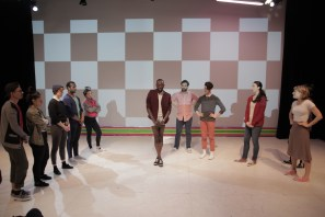 """Raja Feather Kelly showing a dance step to the company of """"Color Me Warhol,"""" a piece for the feath3r theory imagining what A Chorus Line would be like if Warhol had created it."""