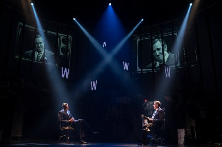 Bertie Carvel as Rupert Murdoch and Kevin Pariseau as his TV host interrogator