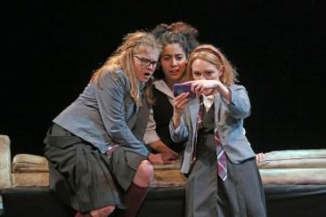 Sophie Kelly-Hedrick, Sharlene Cruz, and AnnaSophia Robb as the witches
