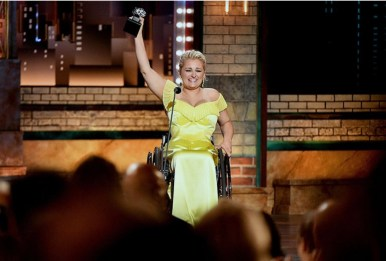 Ali Stroker with Tony trophy in hand