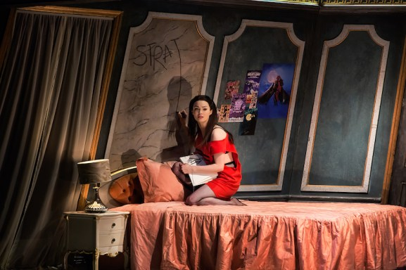 "Christina Bennington as Raven in her bedroom. Notice the name ""Strat"" on her wall"