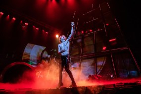 Andrew Polec as Strat, leader of The Lost, eternally 18, doing a rock star pose.