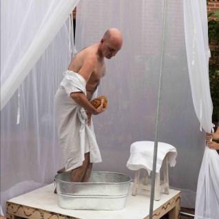 Rafael Sanchez bathing ritual in prologue