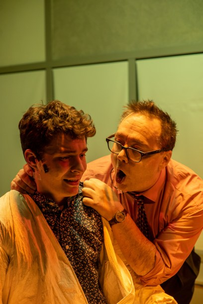 Emilio Christopher Cuesta as Nathaniel and Patrick McCartney as Mr. Charles, his boss