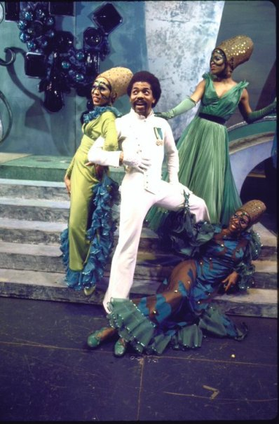 "Actor Andre De Shields (C) w. cast in a scene fr. the Broadway musical ""The Wiz""."