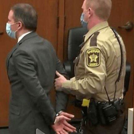 Convicted murderer Derek Chauvin being led from the prison