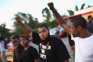 The people of Ferguson protest the killing of one of their own.