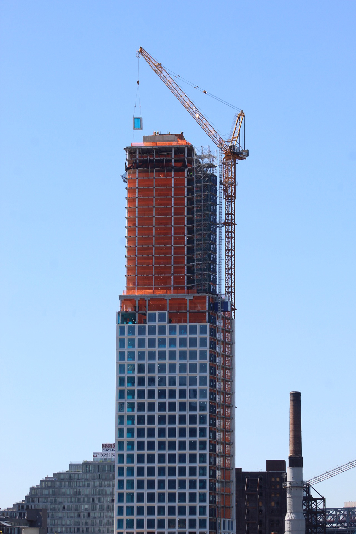 Cantilevering One South First Tops Out Over Domino Park