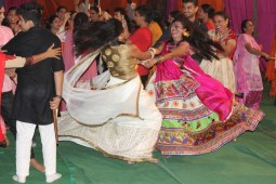 Youngsters dancing in the color of Garba and Dandiya
