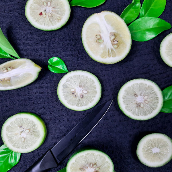 Image of fresh sliced limes and a knife.