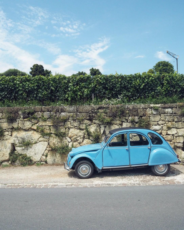 A vintage blue car in a French village near Bordeaux