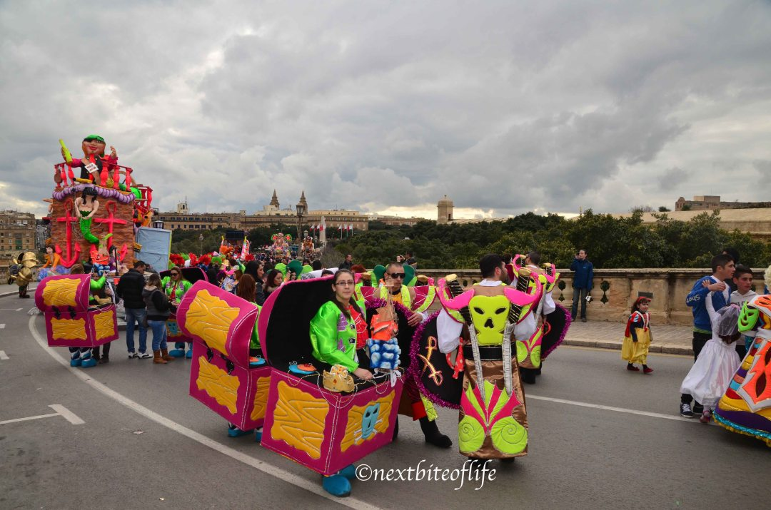 carnival participants in boxes costumes