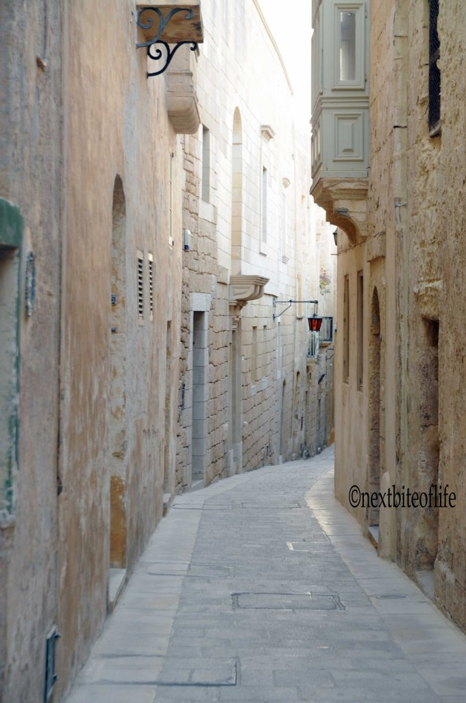 Mdina, narrow street and Maltese window in malta
