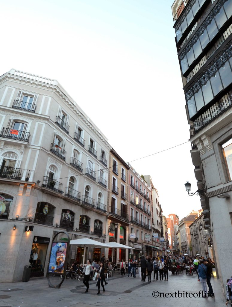 Madrid visit like locals - street with people madrid center