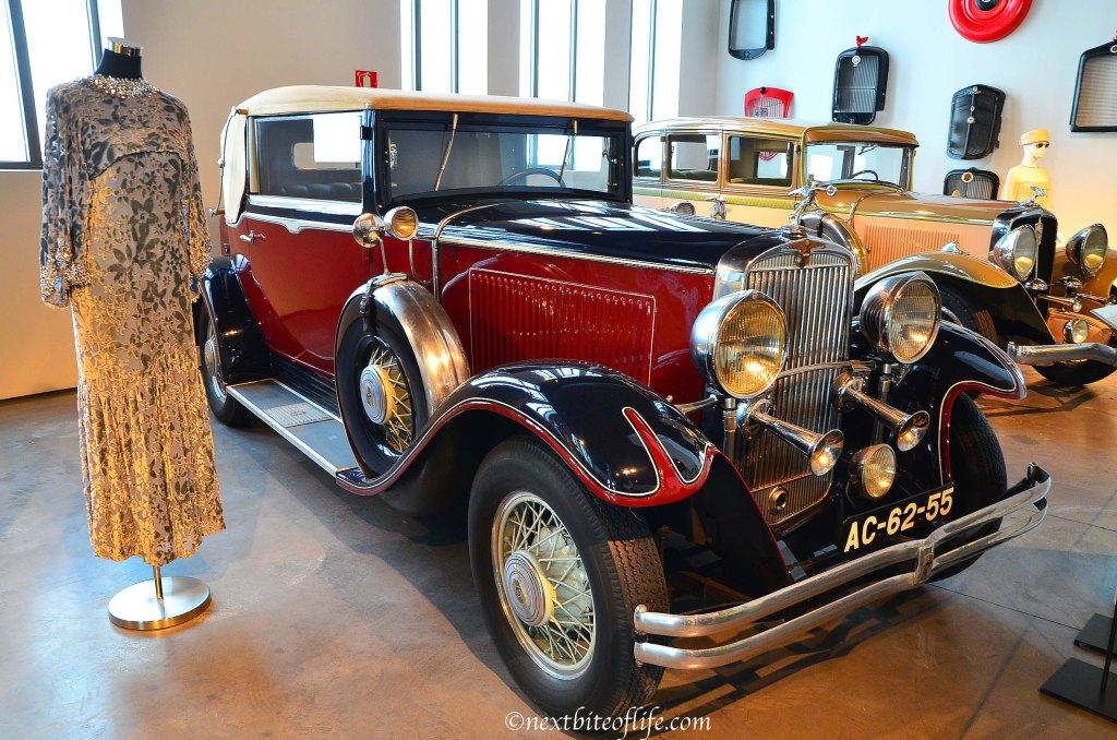 dress and classic car at car museum malaga