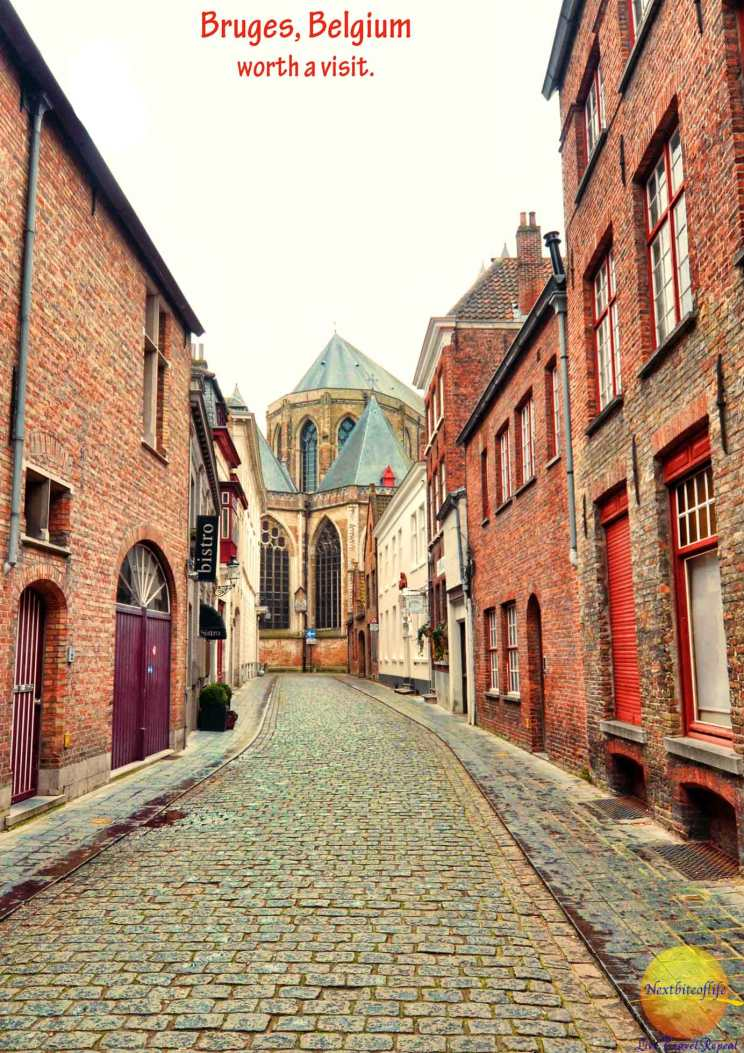 quaint street with bistro in bruges