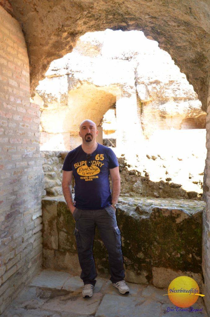man at italica ruins seville