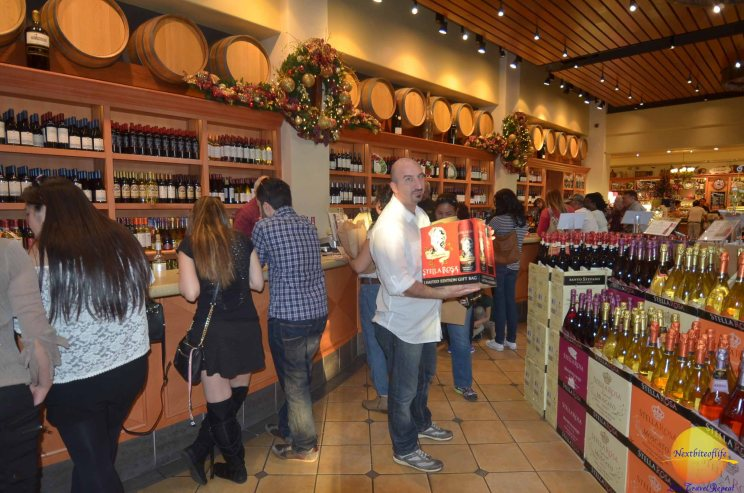 man holding box of wine at san antonio winery
